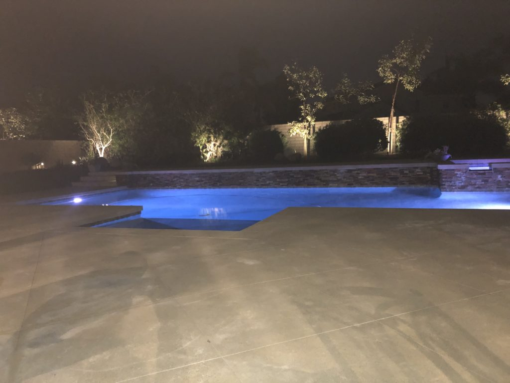 A pool lit up at night